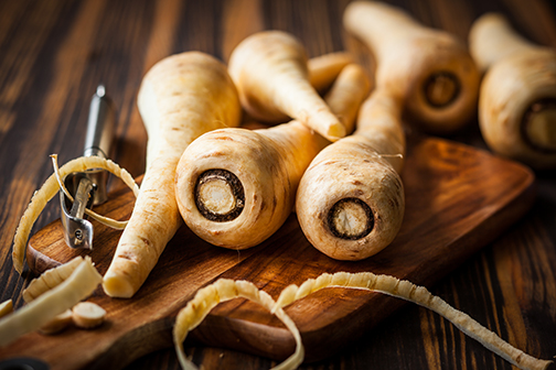 photo of fresh parsnips on a wooden table
