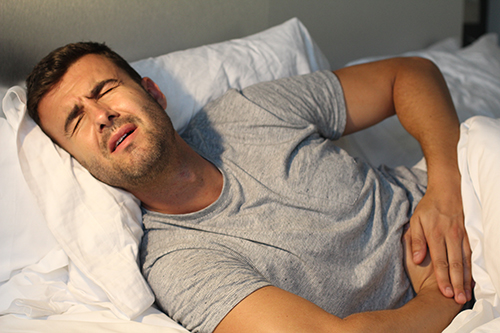 digestive disorder | photo of man suffering with stomach pain